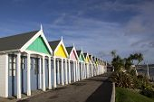 A Row Of Beach Huts At Weymouth, A Town In Dorset On The South Coast Of England, Uk. poster