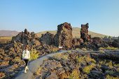 Woman Walking On North Crater Flow Trail, Craters Of The Moon National Monument, Idaho, Usa poster