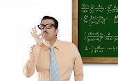 Genius nerd easy found the solution of a mathematical formula in blackboard [photo-illustration]