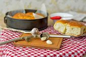 Garlic Slices On The Board, Garlic Press On The Background Of Bread In The Form And On A Red And Whi poster