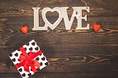 Love Word With Decorative Hearts And Giftbox On White Wooden Background. Free Space. Valentines Day  poster