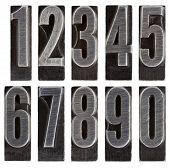 stock photo of arabic numerals  - a full set of ten arabic numerals 0 to 9 in old grunge metal letterpress printing blocks isolated on white - JPG
