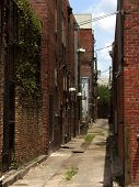 picture of ybor city  - alley between historic buildings of the cuban cigar manufacturing center of ybor city section of tampa - JPG
