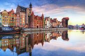 Gdansk with old town and port crane reflected in Motlawa river at sunrise, Poland. poster