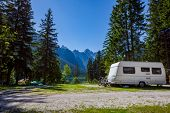 Family vacation travel, holiday trip in motorhome RV, Caravan car Vacation. Beautiful Nature Italy n poster