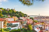 Lisbon, Portugal City Skyline with Sao Jorge Castle and the Tagus River. poster