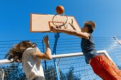 Streetball Basketball Game With Two Players, Teenagers Girl And Boy With Ball, Outdoor City Basketba poster