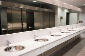 image of public housing  - Public empty restroom with washstands mirror - JPG