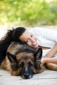Young happy woman with is Belgian Malinois dog.