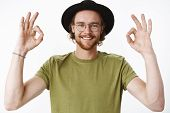 Waist-up Shot Of Friendly-looking Energized And Pleased Young Creative Bearded Male In Glasses And H poster