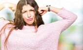 Young beautiful woman wearing pink sweater showing arms muscles smiling proud. Fitness concept. poster