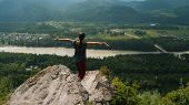 Rear View Of Hiker Girl Lifting Arm Up Is Celebrating Life Scenic Nature Landscape Enjoying Vacation poster