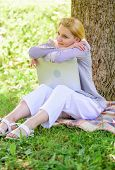 Technology And Internet Concept. Dream About New Job Or Relocation. Girl Laptop Dreaming In Park Sit poster