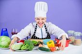 Woman Chef Cooking Healthy Food. Gourmet Main Dish Recipes. Delicious Recipe Concept. Girl In Hat An poster