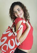 Beautiful Young Woman With Red Bag
