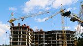 Construction Site. Concrete Building Under Construction. Construction Cranes. poster