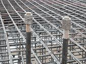 Two Steel Anchor Bolts With Screw Nuts And Steel Grid On Tower Crane Footing Reinforcement poster