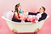 Your Hair Care Routine. Couple Of Mime Man And Sexy Woman Enjoy Bathing. Couple In Love In Bath Tub. poster