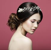 Fashion bride in gorgeous wedding dress studio portrait over pink background. Beautiful model with b poster