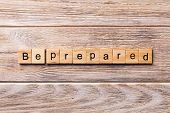 Be Prepared Word Written On Wood Block. Be Prepared Text On Wooden Table For Your Desing, Concept poster