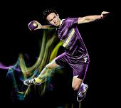 one caucasian handball player young man isolated on black background with speed light painting effec poster