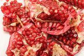 Pomegranate On A White Background. Natural Fruit. Red Fruit. Pomegranate On The Table. poster