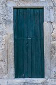 The Old Wooden Door. Ancient Antique Wooden In An Old Wall. Ancient Decorative Wooden Door. Historic poster