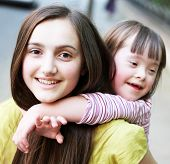 stock photo of playgroup  - Portrait of beautiful young girls in the park  - JPG
