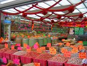 image of chinese food  - Chinatown market with bins of dried foods and bright price tags - JPG