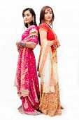 picture of bangla  - Two beautiful Bangali brides in colorful dresses isolated - JPG