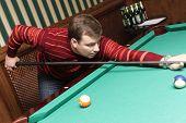 picture of hustler  - The billiard player strikes a billiard ball - JPG