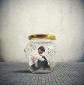 foto of hermetic  - Concept of hermetic businessman closed in a jar - JPG