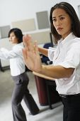 stock photo of tai-chi  - Businesswomen practicing tai chi - JPG