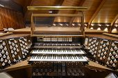 stock photo of wind instrument  - Church Pipe Organ Keyboards Pedalboard and Control Buttons - JPG