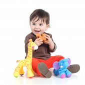 stock photo of animal teeth  - Pretty little baby girl playing with animal toys isolated on a white background - JPG