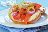 stock photo of bagel  - Smoked salmon lox with cream cheese capers and red onion on toasted Asiago cheese bagel - JPG