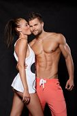 picture of caress  - Young muscular man holding a young woman who kisses him on the cheek - JPG