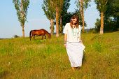 picture of swales  - beautiful young woman and horse on the lawn - JPG