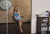 pic of shelving unit  - Full length of a beautiful young woman sitting on chair at office doorway - JPG