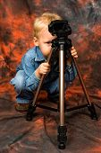Child Playing With Tripod