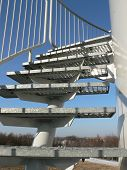 stock photo of higher power  - Metal terrace stairs by wind power plant - JPG
