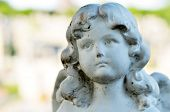stock photo of tombstone  - Cute Angel statue with weathered baby face - JPG
