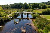 pic of devonshire  - Viewed from the Postbridge ancient clapper bridge at in Dartmoor National Park Devon England UK - JPG