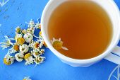 stock photo of chamomile  - Chamomile tea in white cup and dried chamomile flowers - JPG