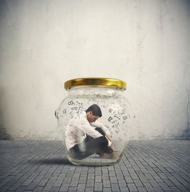 stock photo of hermetic  - Concept of hermetic businessman closed in a jar - JPG