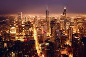 stock photo of illinois  - City of Chicago. Aerial view of Chicago downtown at nigh from high above.