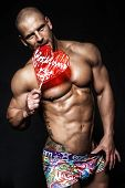 stock photo of striptease  - Sexy handsome man posing - JPG