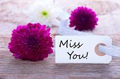 pic of missing  - Label with Miss You and Flowers as Background - JPG