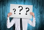 stock photo of anonymous  - Business man cover face with question  board - JPG