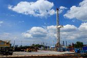 image of oil derrick  - Land Drilling Rig in Yard  - JPG